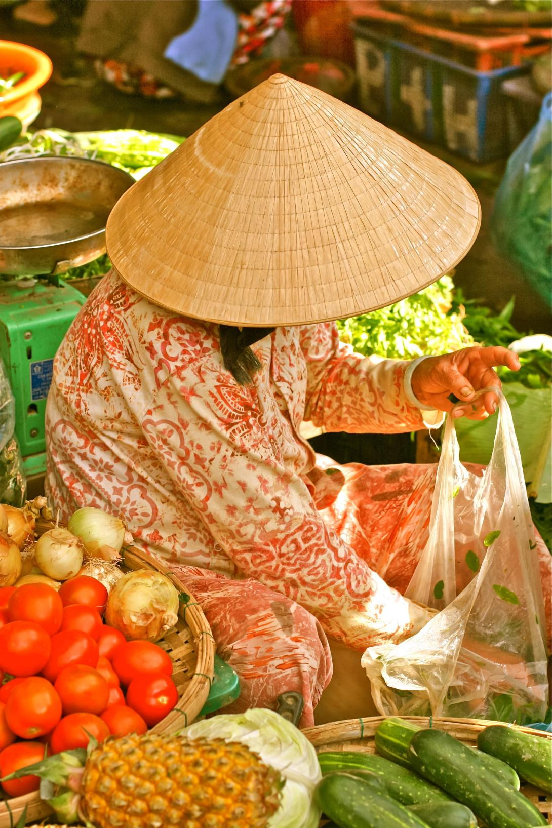 Hanoi street market vendor selling fruit and vegetables